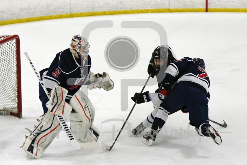 Holy Cross forward Peter Crinella (13) USA Hockey National University Team Alex Temby University of Colorado (7)