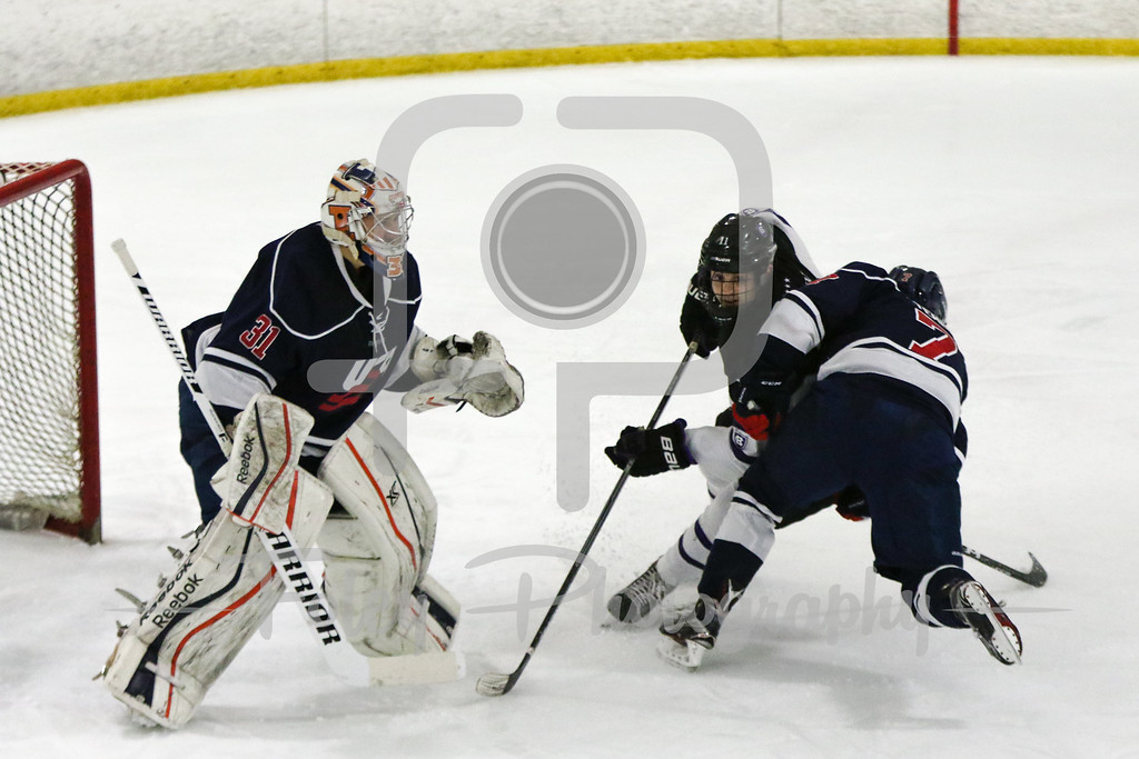 Holy Cross forward Peter Crinella (13) USA Hockey National University Team Alex Temby University of Colorado (7)