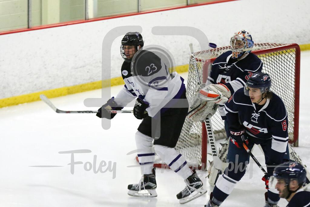 Holy Cross forward Ryan Ferrill (23) USA Hockey National University Team goalie Joe Olen (University of Illinois) (31)