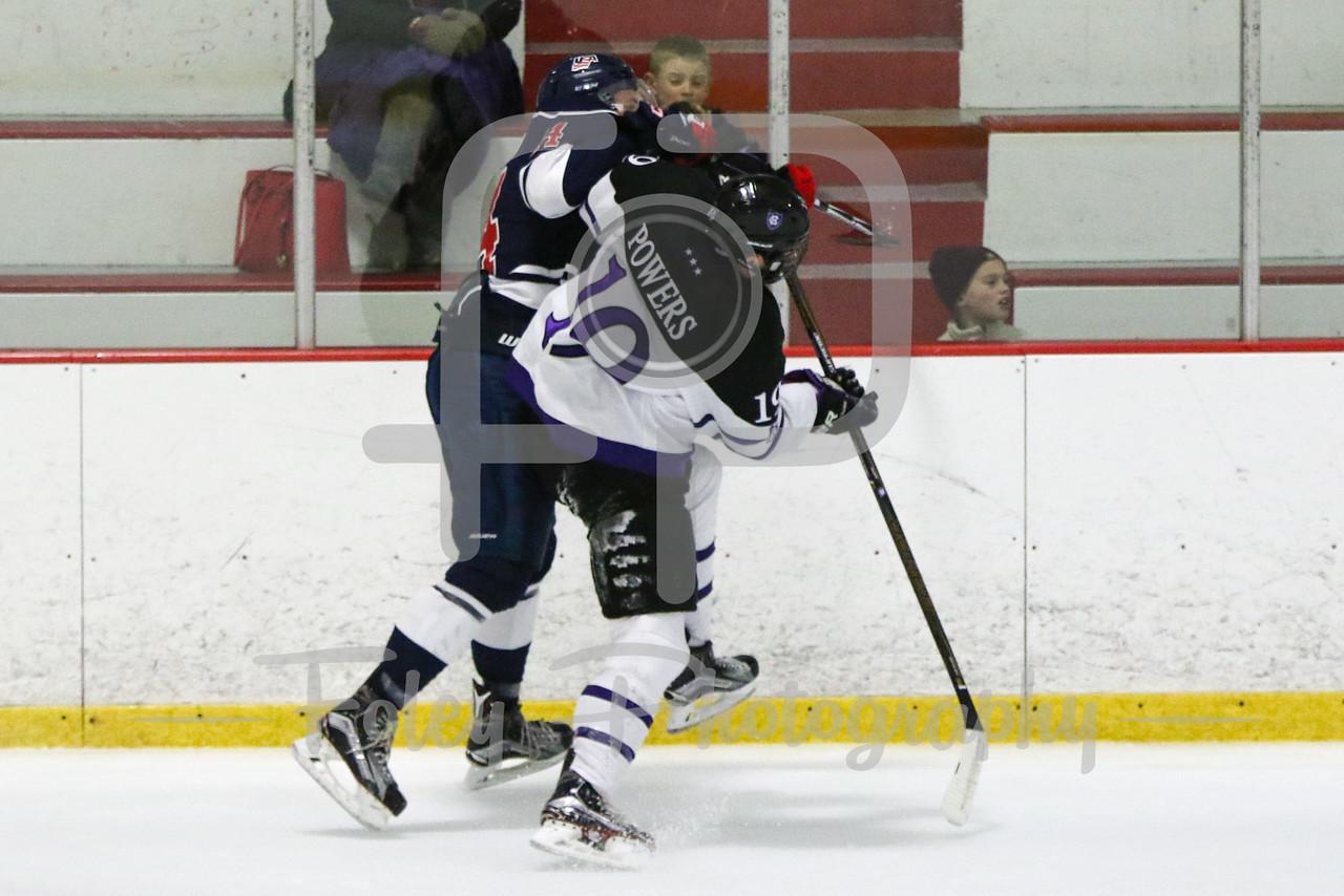 USA Hockey National University Team Taylor Herndon (University of Central Oklahoma) (14) Holy Cross forward Owen Powers (19)