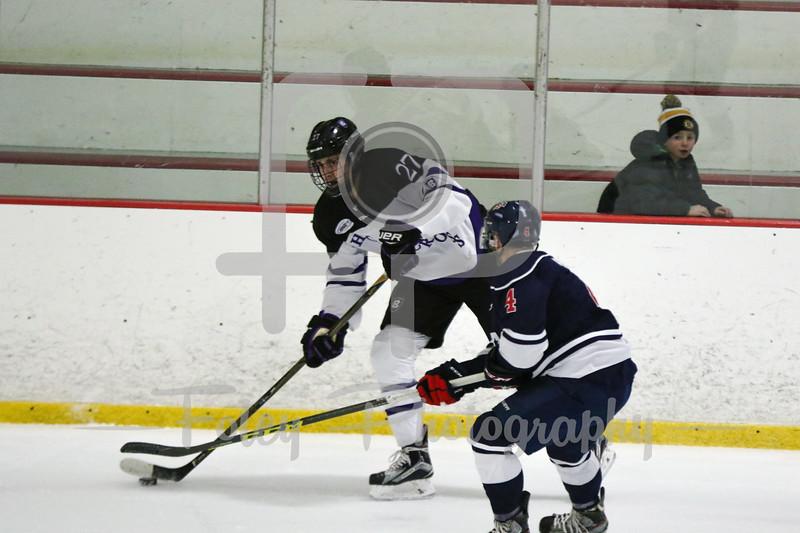 Holy Cross forward Danny Lopez (27) USA Hockey National University Team Ryan Urso (University of Michigan-Dearborn) (4)