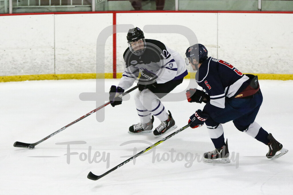 Holy Cross forward Scott Pooley (12) USA Hockey National University Team Jake Uglem (Iowa State University) (5)