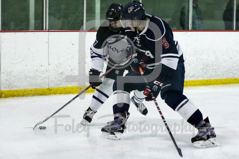 Holy Cross forward T.J. Moore (17) USA Hockey National University Team Nicholas Zern (Minot State University) (8)