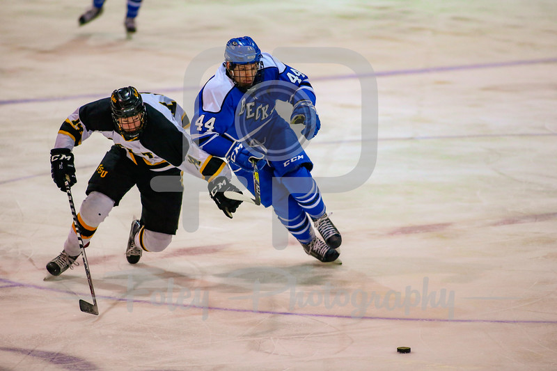 Becker College Hawks forward James Wallace (44) Framingham State Rams forward Cameron Klahre (14)