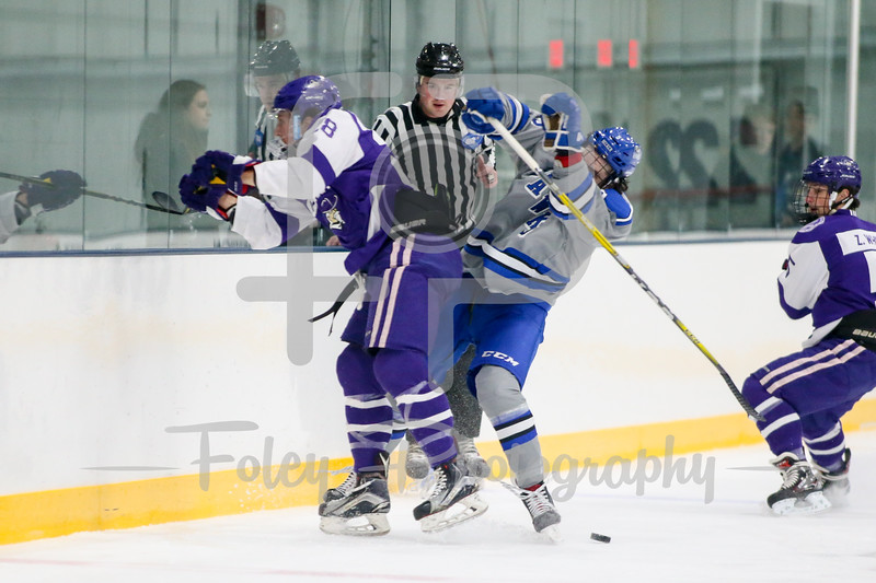 Becker College Hawks forward Aaron Deady (5) Curry College Colonels forward Lionel Mauron (18)