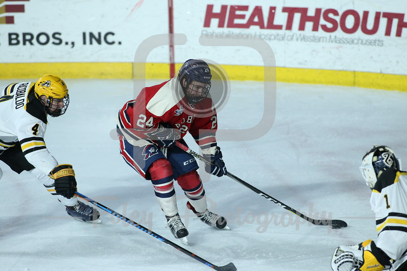 Robert Morris Colonials forward Alex Tonge (24) AIC Yellow Jackets defenseman Dominic Racobaldo (4)