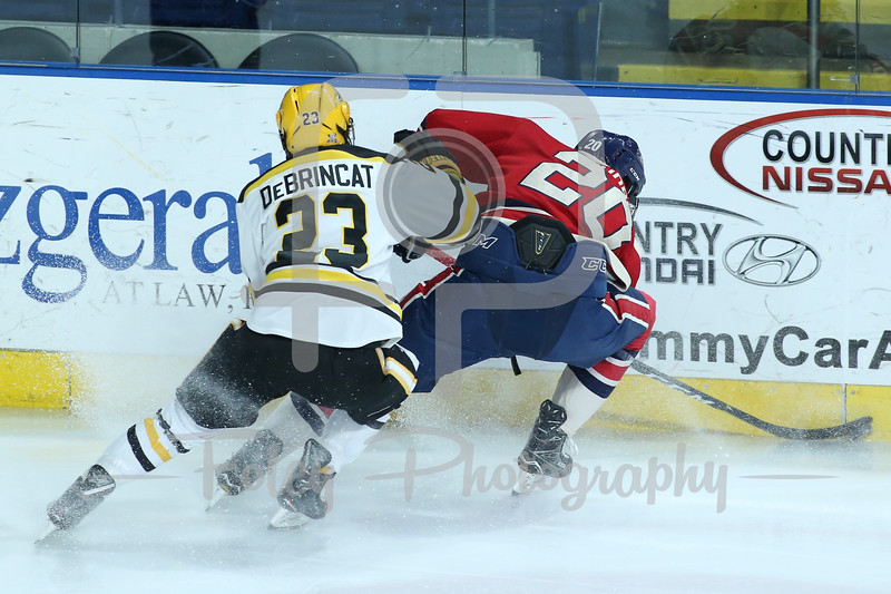 AIC Yellow Jackets defenseman Andrew DeBrincat (23) Robert Morris Colonials forward Timmy Moore (20)