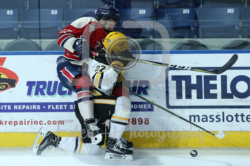 Robert Morris Colonials forward Brandon Watt (17) AIC Yellow Jackets defenseman Janis Jaks (27)