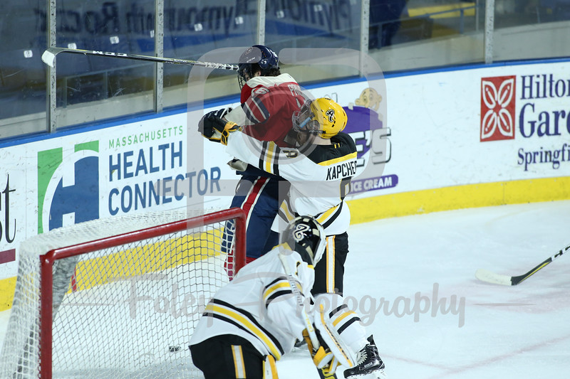 AIC Yellow Jackets defenseman Brennan Kapcheck (8) Robert Morris Colonials forward Nick Prkusic (16)