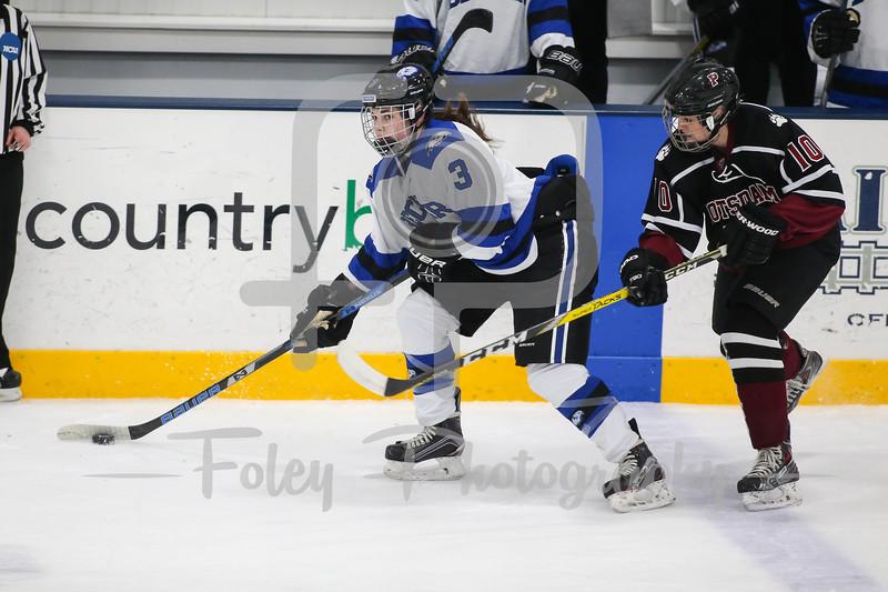 Becker College Hawks defenseman Samantha Talmadge (3) SUNY-Potsdam forward Tatum Walber (10)