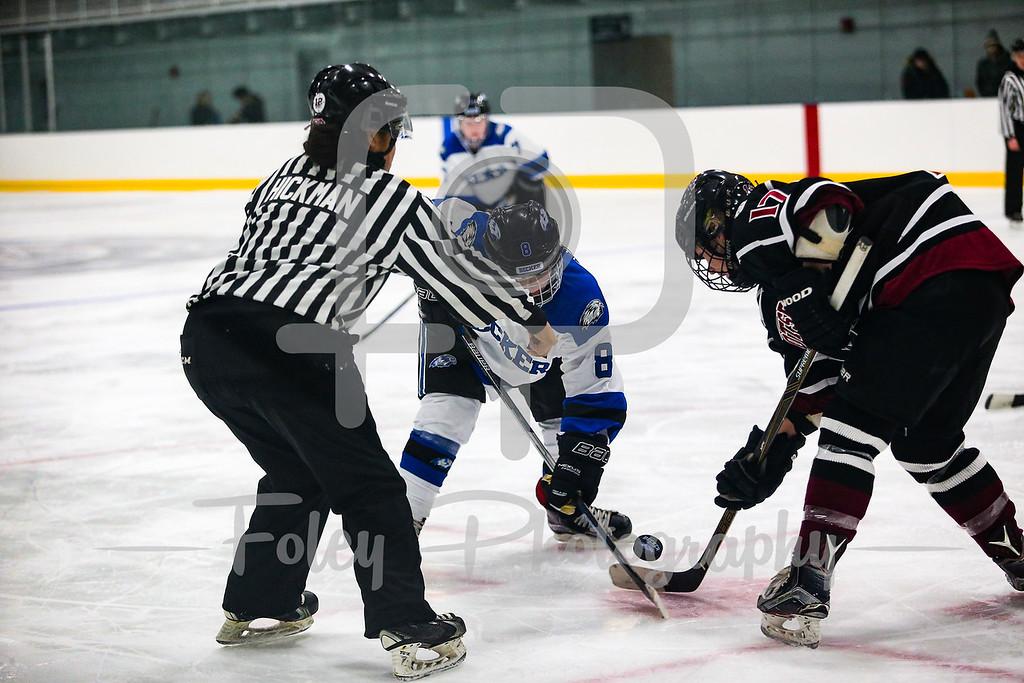 Becker College Hawks forward Brittany Aiello (8) SUNY-Potsdam forward Lucy Condon (17)