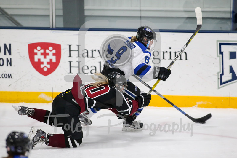 Becker College Hawks forward Rachel Pitcher (9) SUNY-Potsdam forward Tatum Walber (10)