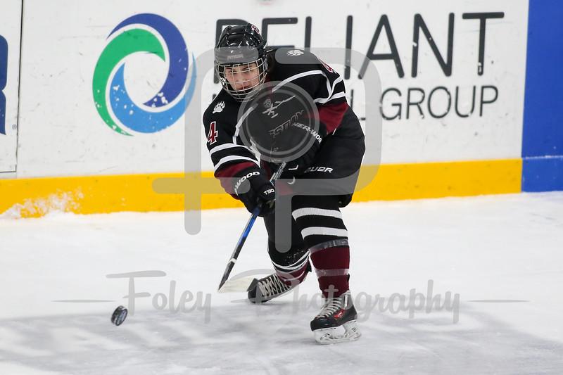 SUNY-Potsdam defenseman Emily Burke (4)