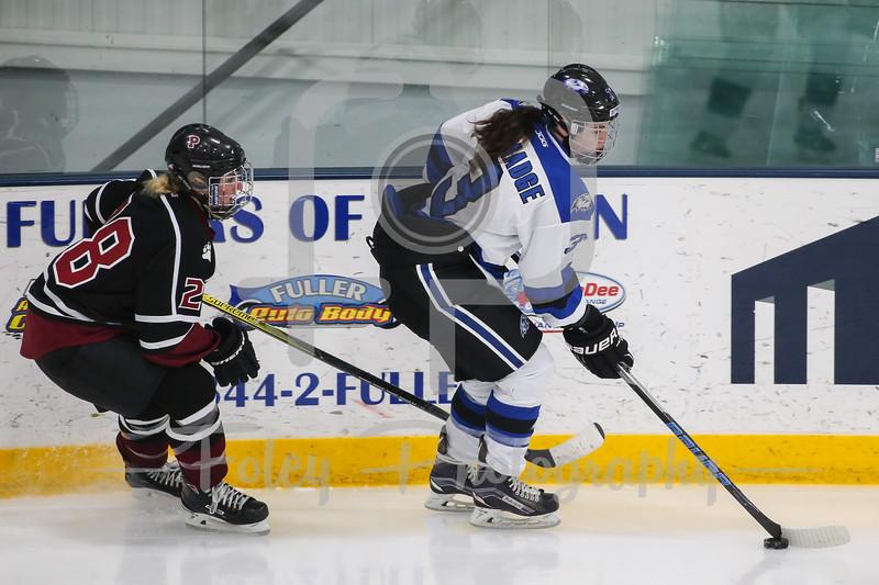 Becker College Hawks defenseman Samantha Talmadge (3) SUNY-Potsdam forward Jenna Patterson (28)
