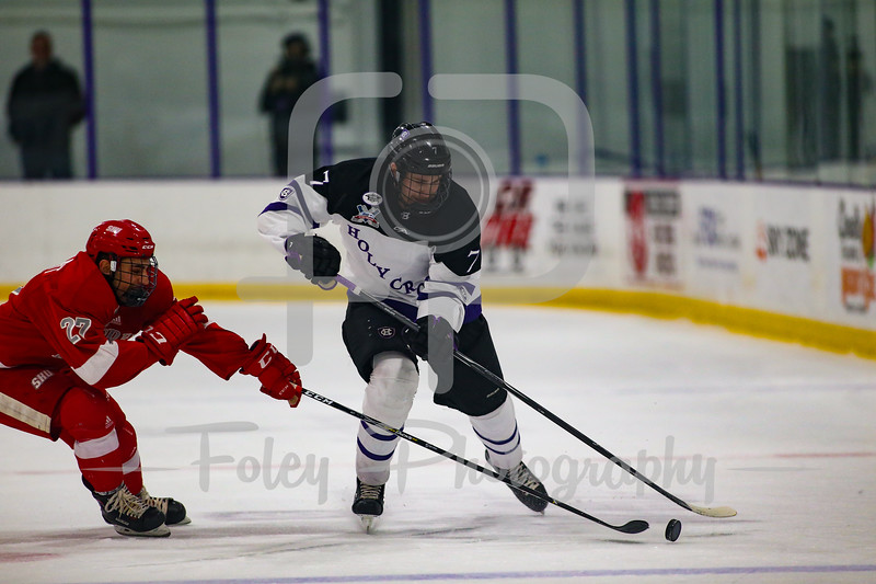 Holy Cross Crusaders defenseman Johnny Coughlin (7) Sacred Heart Pioneers forward Jackson Barliant (27)