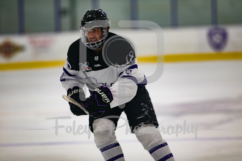 Holy Cross Crusaders forward Jay Mackie (18)
