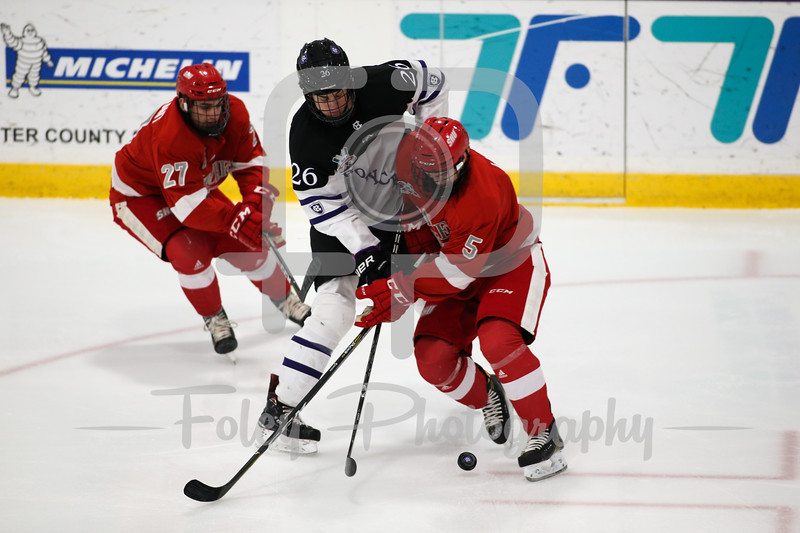 Sacred Heart Pioneers defenseman Christian Lloyd (5) Holy Cross Crusaders forward Pete Kessel (26)
