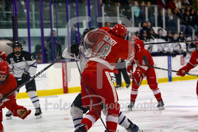 Holy Cross Crusaders forward Kevin Darrar (10) Sacred Heart Pioneers defenseman Michael Gilroy (18)