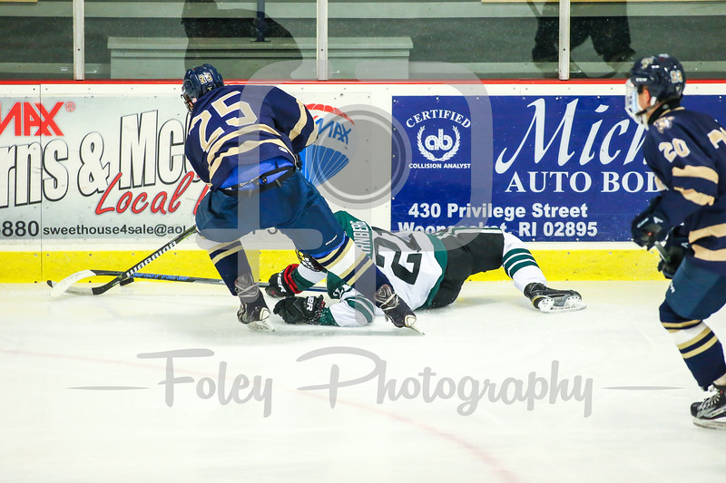 Suffolk College Rams defenseman Shayne Bailey (25) Nichols College Bison Oliver Arnberg (21)