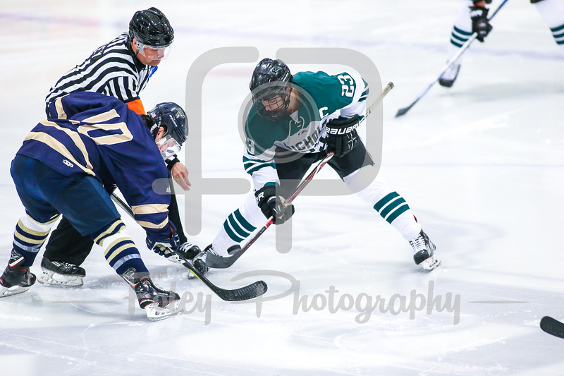 Nichols College Bison Scott Cuthrell (23) Suffolk College Rams forward Connor Henry (10)