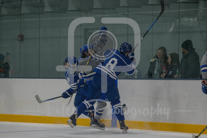 Becker College Hawks forward Corey Schafer (24) University of New England Nor'easters defenseman Tucker Ross (8)