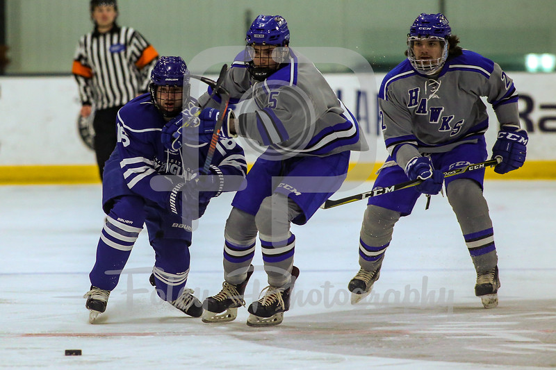 University of New England Nor'easters forward Derek Mecrones (16) Becker College Hawks forward Aaron Deady (5)