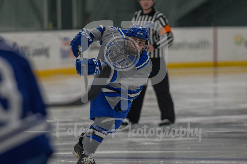 Becker College Hawks defenseman Brian Greene (12)