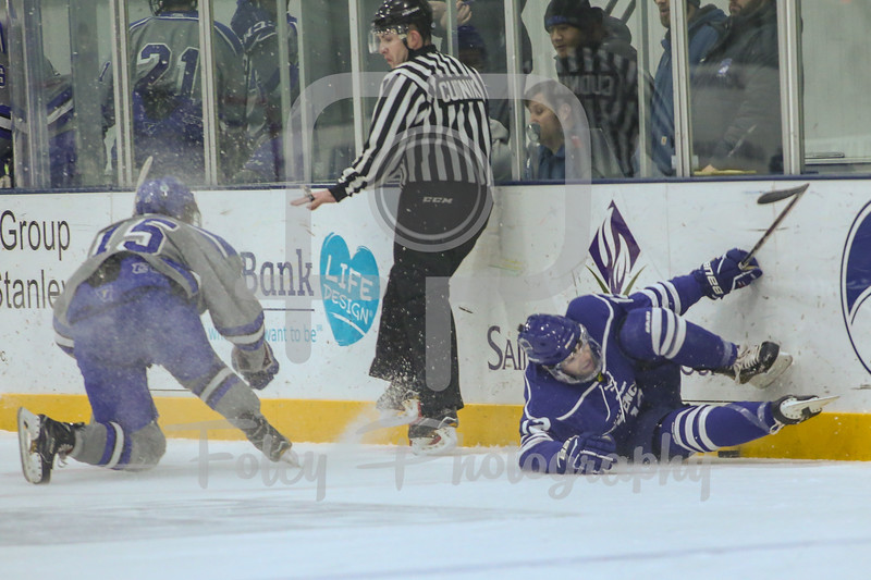 Becker College Hawks forward MacGregor Howey (15) University of New England Nor'easters forward Andrew Slotnick (12)