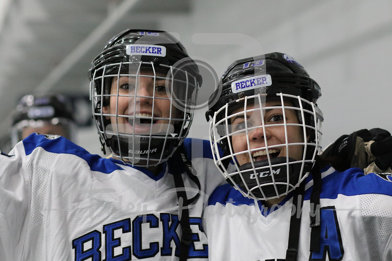 Becker College Hawks forward Sarah McSweeney (13) Becker College Hawks defenseman Madison Maloney (16)