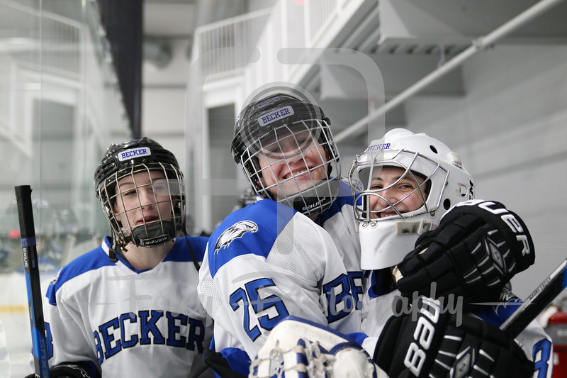 Becker College Hawks forward Anastasia Thompson (25) Becker College Hawks goaltender Julia Johnson (35)