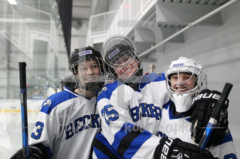 Becker College Hawks forward Katherine Capobianco (23) Becker College Hawks forward Anastasia Thompson (25) Becker College Hawks goaltender Julia Johnson (35)