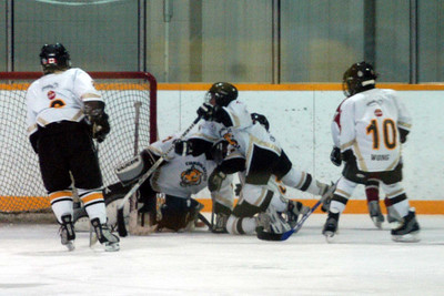 This is what you call tough D ... all back to help our goalie