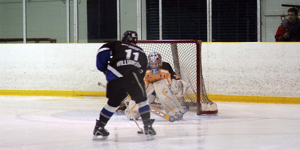 Game 1 on Monday Dec 28 of the December Chedoke Tournament is against the Oakville Titans.  The Coronation team received new Christmas gear of turkey dressing and understandably succumbed to Oakville by a score of 0-4. This frame is the first of a 4 frame shot capturing Oakville's opening goal on a 2 on 0.