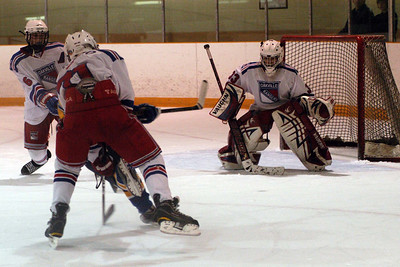... he did not miss this one for the 4th goal ... it hit its mark in the top corner glove side  ...  Can you locate the puck?  While we're at it, can you spot Brandon?