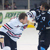 Rockford's Kyle Hagel (#14) and Milwaukee's Kelsey Wilson (#17) drop the gloves