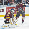 Chicago Wolves goaltender Eddie Lack makes a pad save