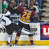 Chicago Wolves #26 Matt Clackson lays a check on Milwaukee Admirals #3 Jeff Foss for the second time on the same shift