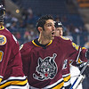 Chicago Wolves Mark Mancari reacts to a shot in warmups