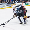 Admirals Chris Mueller battles the puck from Chicago Wolves #6 Kevin Connauton