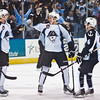 Milwaukee Admirals Taylor Beck (center) celebrates after scoring his first professional goal