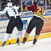 Chicago Wolves #26 Matt Clackson lays a check on Milwaukee Admirals #3 Jeff Foss