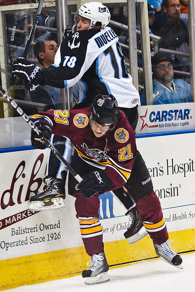 Chicago Wolves #21 Kevin Doell ducks a check by Milwaukee Admirals #18 Chris Mueller