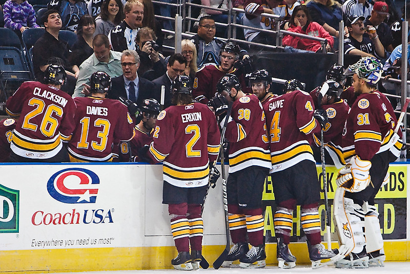 Chicago Wolves head coach Craig MacTavish talks to his players during a timeout