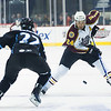 Chicago Wolves #24 Mark Mancari attemps to stick-handle past Milwaukee's #22 Scott Valentine