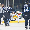 Michael Latta #17 of the Admirals knocks Chicago Wolves #27 Antoine Roussel off balance