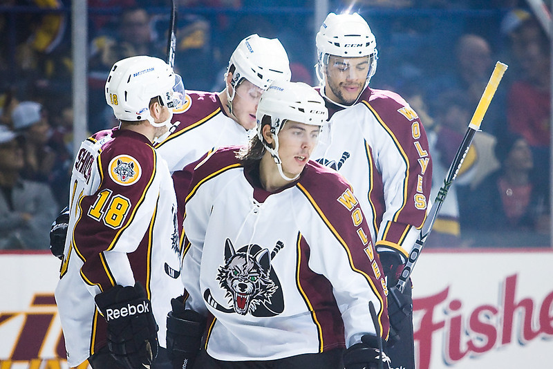 Chicago Wolves players celebrate after tying the game