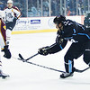 Chris Mueller shoots the puck through Wolves defenseman #4 Yann Sauve  for the Admirals second goal of the game