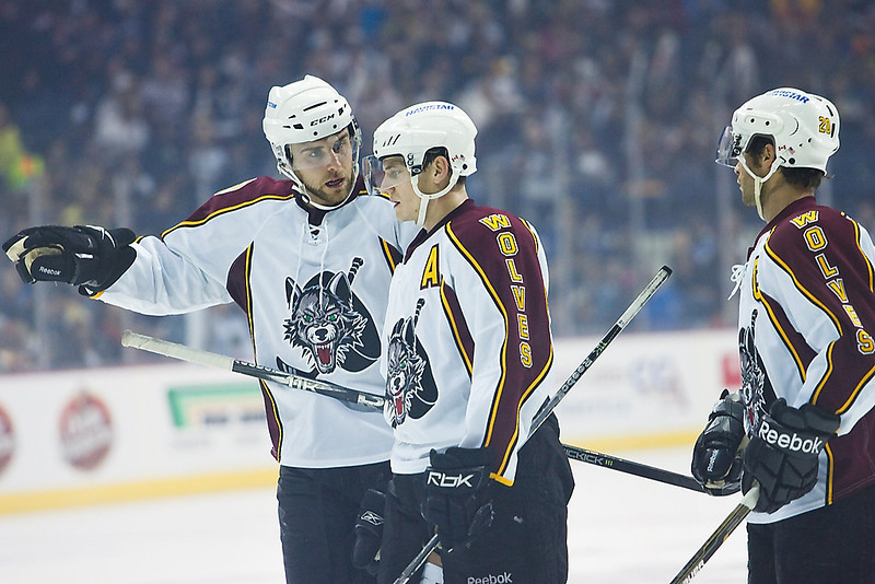 Chicago Wolves Kevin Doell (w/ A) listens to insight from another Wolves player