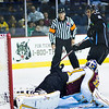 Ryan Thang #8 of Milwaukee watches as the puck goes pasted Eddlie Lack of the Chicago Wolves in the shootout