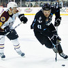 Milwaukee Admirals #41 Taylor Beck attemps to stick handle around Wolves #18 Jordan Schroeder